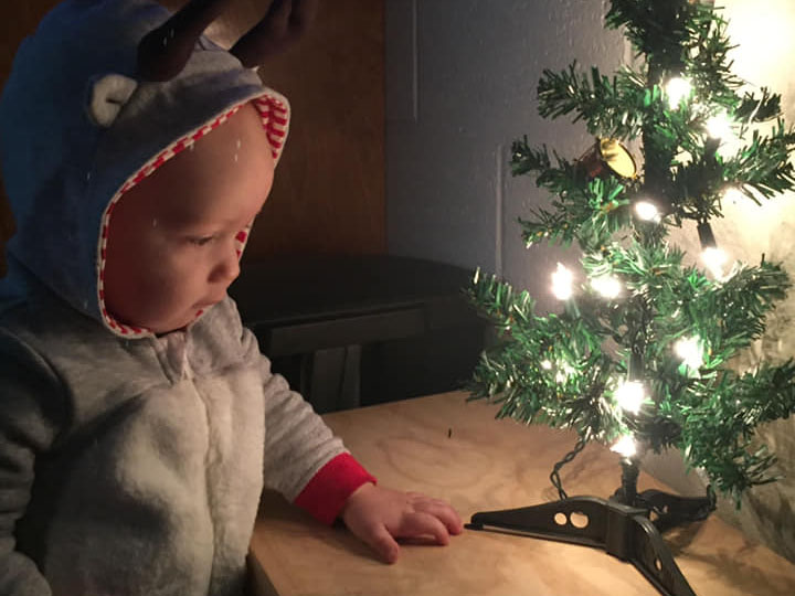 baby looking at christmas tree at a Preschool & Daycare Serving Brighton, MI