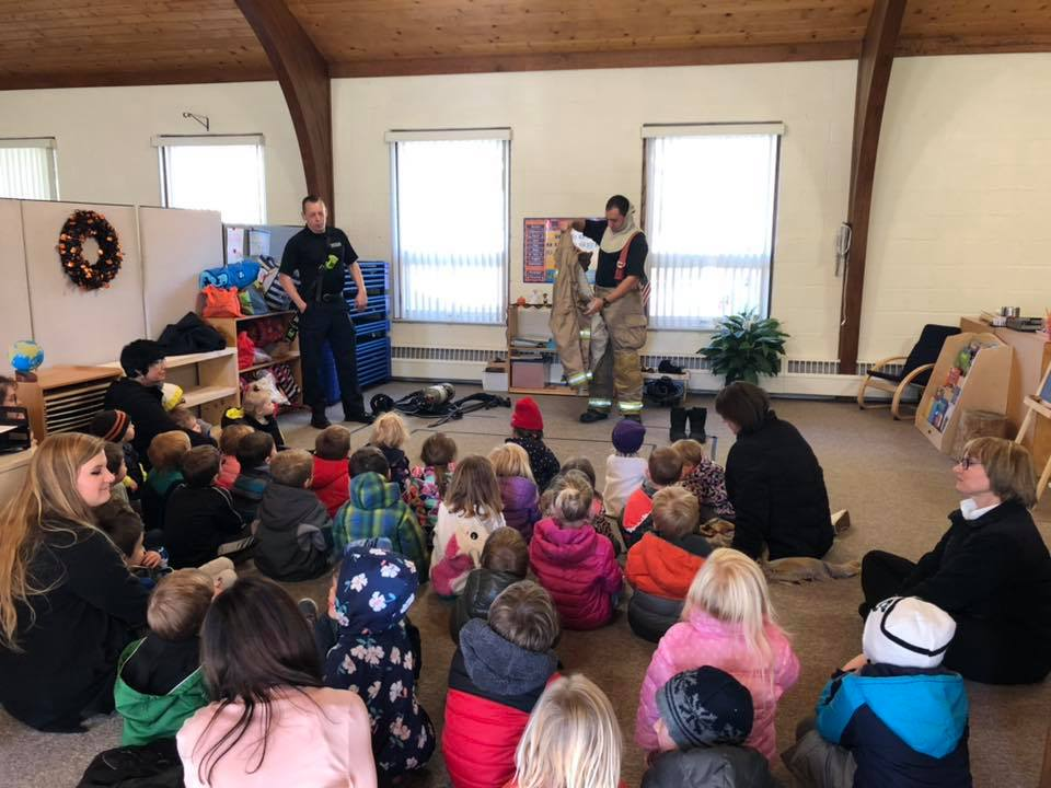 kids in classroom learning from firemen at a Preschool & Daycare Serving Brighton, MI