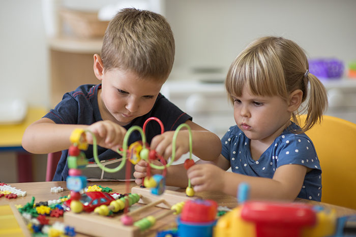 kindergarten kids playing together at a Preschool & Daycare Serving Brighton, MI