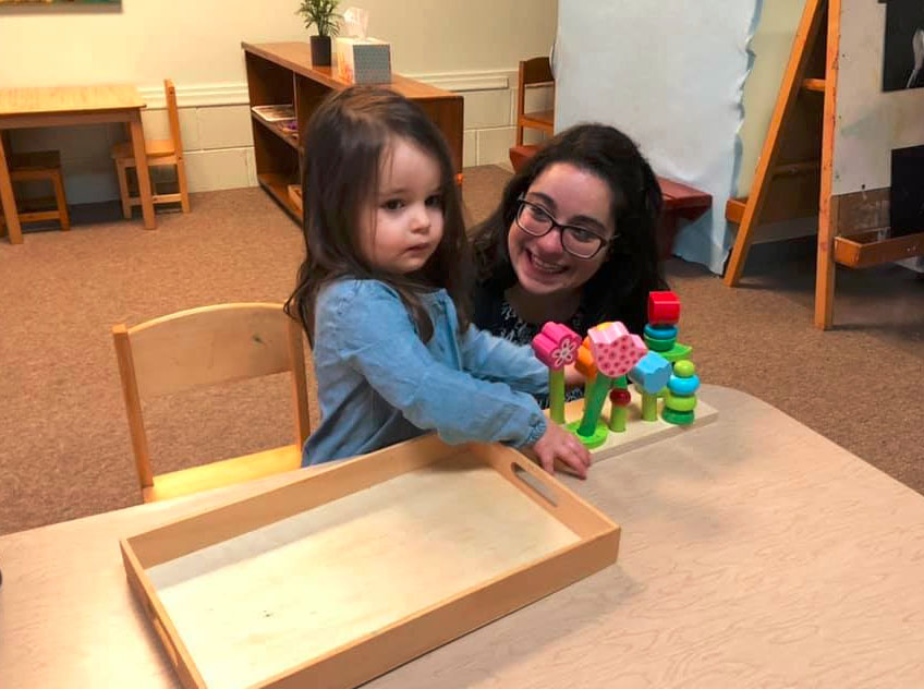 teacher and toddler playing with blocks at a Preschool & Daycare Serving Brighton, MI