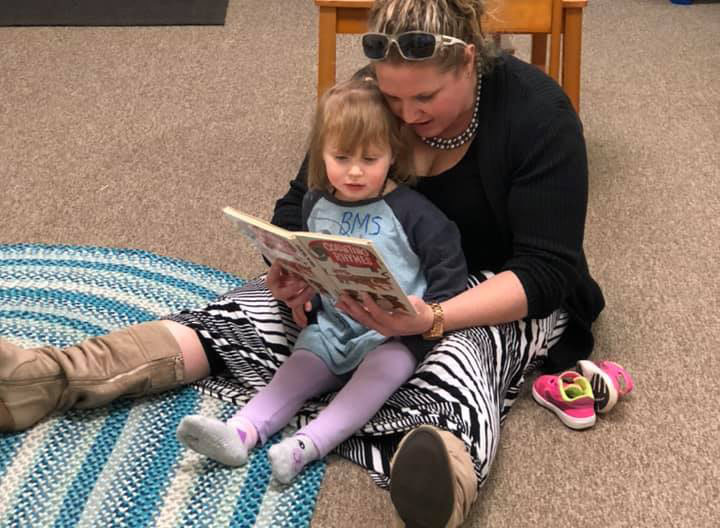 teacher reading to toddler at a Preschool & Daycare Serving Brighton, MI