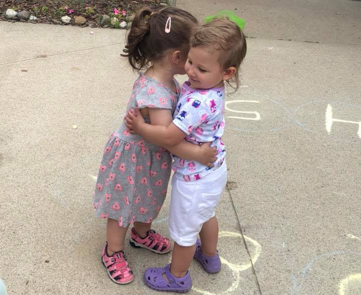 toddlers hugging and making friends at a Preschool & Daycare Serving Brighton, MI