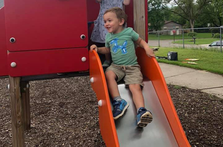 young boy having fun in playground at a Preschool & Daycare Serving Brighton, MI